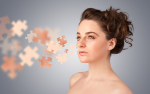 Pretty young girl with skin puzzle illustration on gradient background